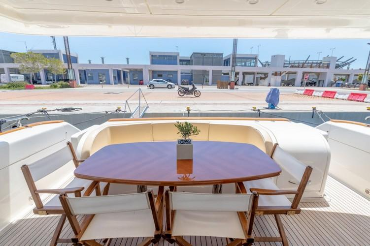 Yacht_VenusSecret_02.jpg Mykonos Outdoor Dining area, table, chairs, flowers, vase