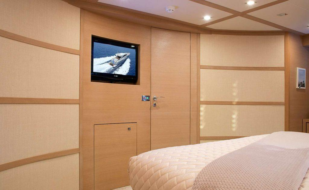 bedroom with wall plasma tv and wooden door