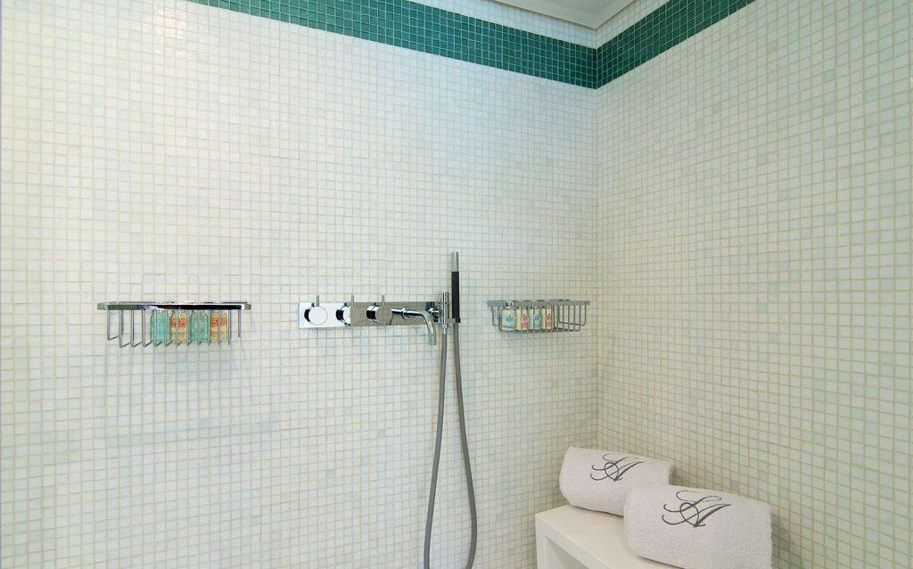 bathrom for shower with colorful tiled