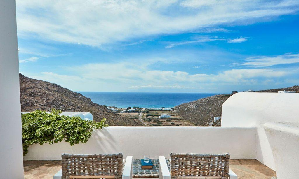 Villa Maksim Agrari Mykonos, balcony view, island, sky, sea, clouds, chairs, table, glass, book