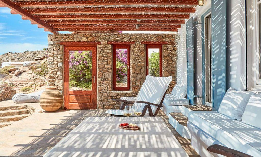 Villa Maksim Agrari Mykonos, outdoor resting area, armchair, glasses, champagne, sofa, pillows, table