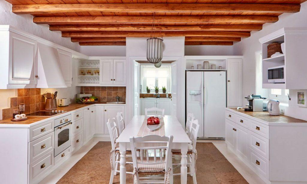 Villa Maksim Agrari Mykonos, kitchen, dining table, chairs, bowl, fruits, fridge, oven, drawers, shelves, microwave, toaster