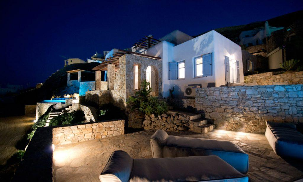 Villa Naenia Psarrou Mykonos, villa exterior, lights, night, sun beds, sky