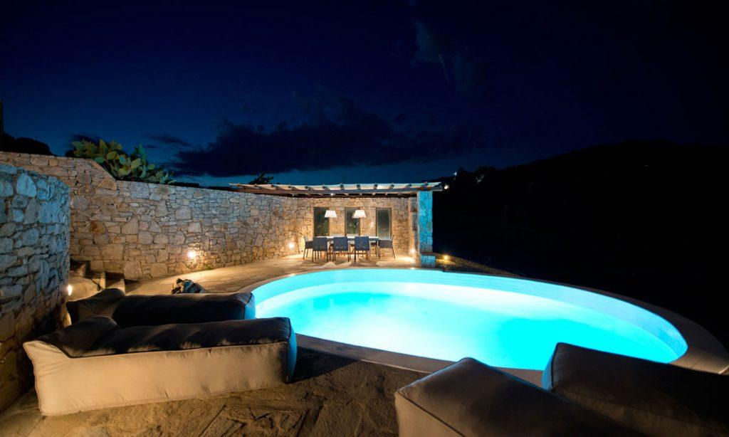 Villa Naenia Psarrou Mykonos, outdoor, pool, night, light, sun beds, sky, clouds