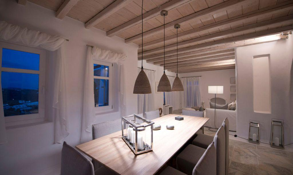 Villa Naenia Psarrou Mykonos, dining area, dining table, chairs, curtains, windows, lamps, candles