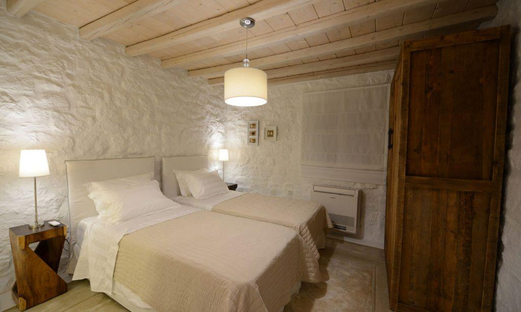 Villa Naenia Psarrou Mykonos, 2nd bedroom, double bed, pillows, closet, nightstands, lamps, curtain, window