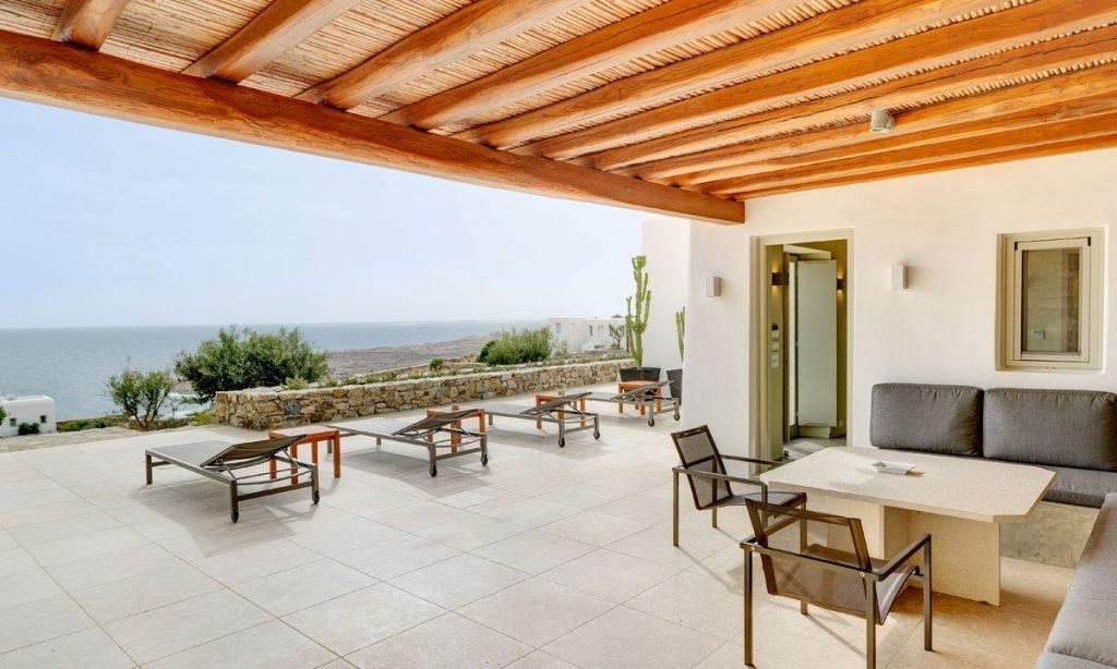 Villa Raisa Super Paradise Mykonos, outdoor, climbers, chairs, table, sofa, pillows, sea, sky