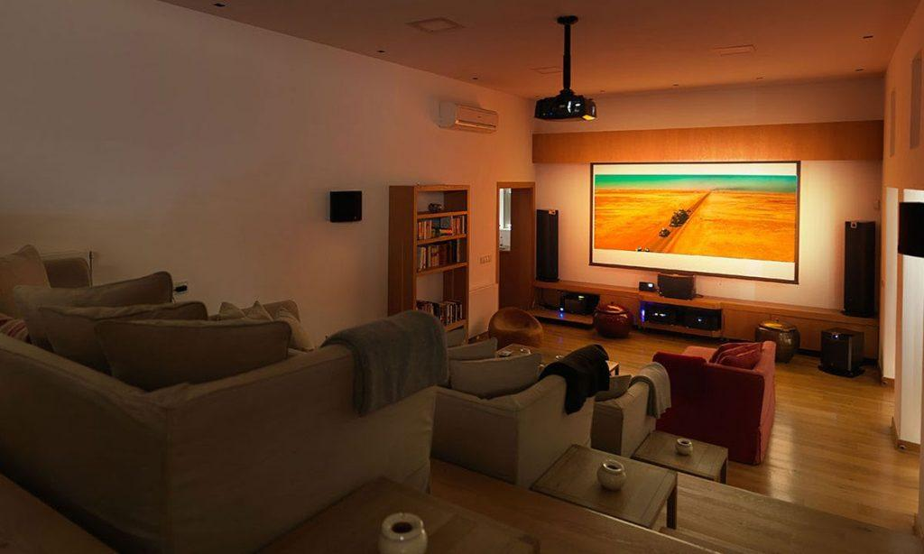 Villa Raisa Super Paradise Mykonos, interior, home cinema, AC, sofas, pillows, living room, home stereo system, shelves, books