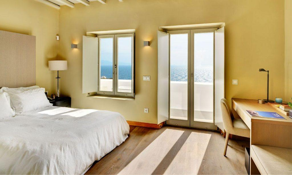 Villa Raisa Super Paradise Mykonos, 3rd bedroom, king size bed, pillows, lamp, nightstand, work desk, chair, lamp