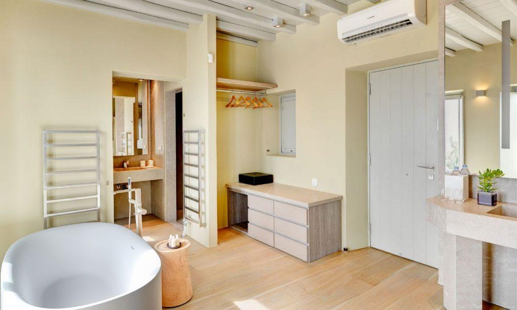 Villa Raisa Super Paradise Mykonos, 3rd bathroom, bathtub, washstand, AC, door, drawers, mirror
