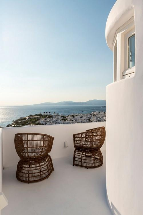 balcony with two chairs to sit on and relax