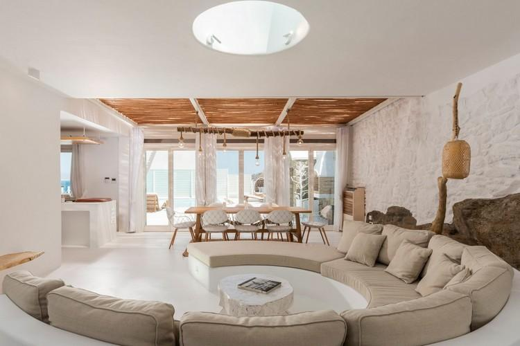 living area with round cozy sofa and window in the ceiling