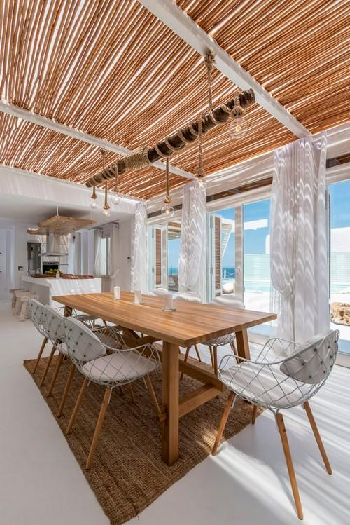 dining area with huge wooden table and soft chairs