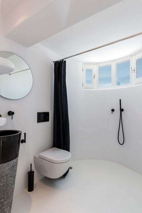 white wall bathroom with huge shower and black curtains
