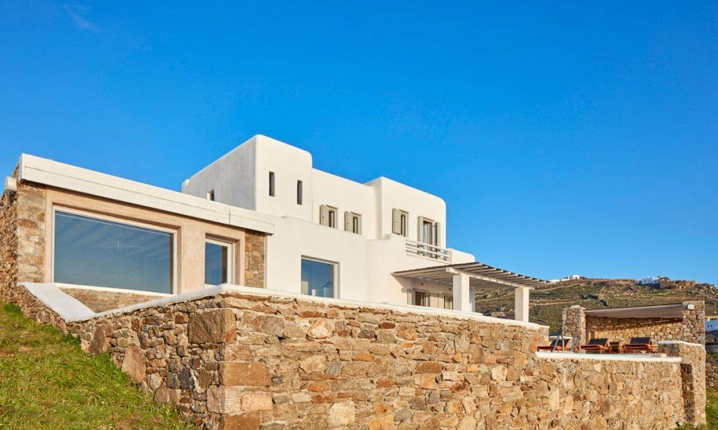 Villa Orion Retreat, Houlakia, Mykonos, villa exterior, sky, stone wall, windows