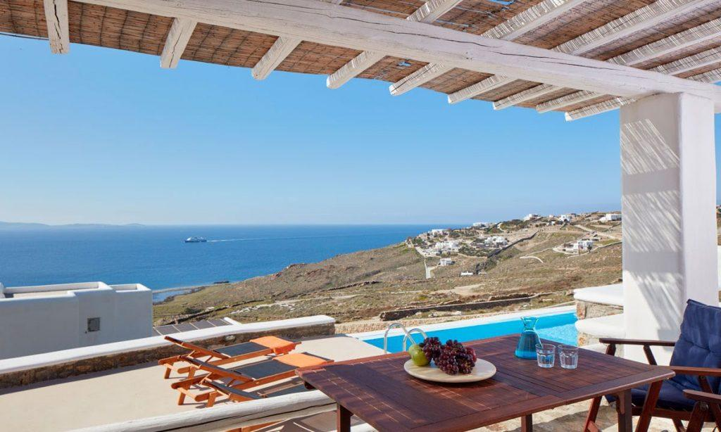 Villa Orion Retreat, Houlakia, Mykonos, outdoor, resting area, sea, sky, horizon, view, pool, climbers, table, fruit