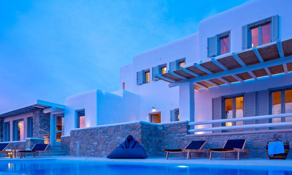 Villa Orion Retreat Houlakia Mykonos, villa exterior, lights, sky, windows, doors, climbers, pool, sun bed
