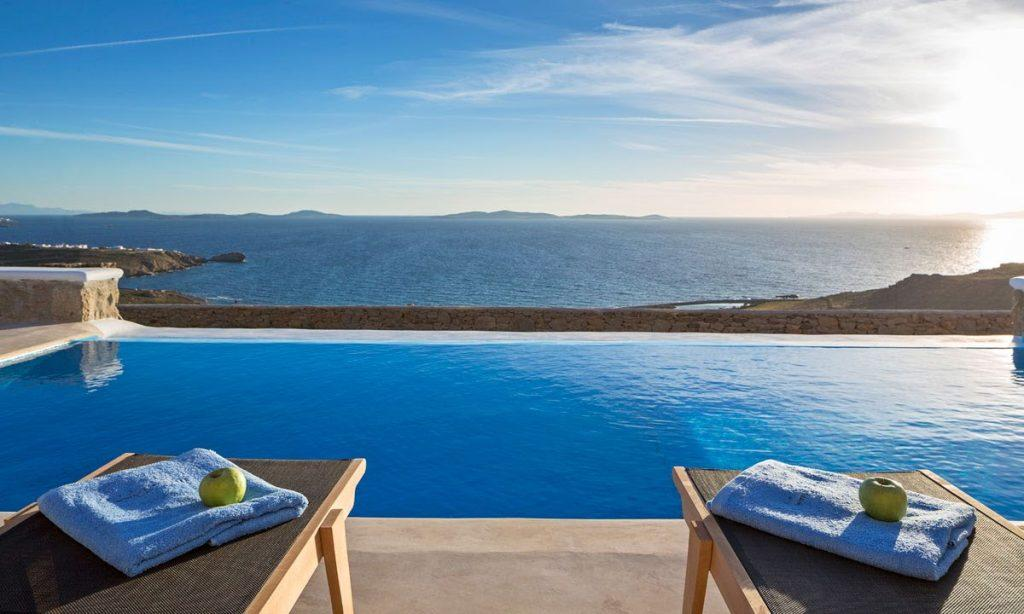 Villa Orion Retreat, Houlakia, Mykonos, outdoor, pool, climbers, towels, apples, sea, sky, clouds