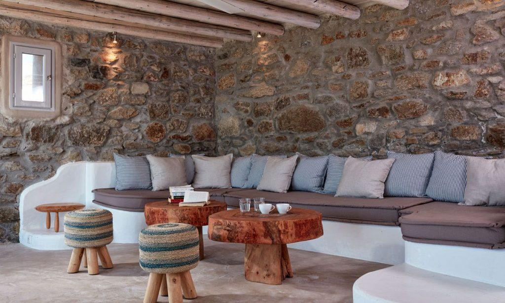 Villa Orion Retreat, Houlakia, Mykonos, outdoor, sofa, pillows, chairs, tables, glasses, cups, books, window