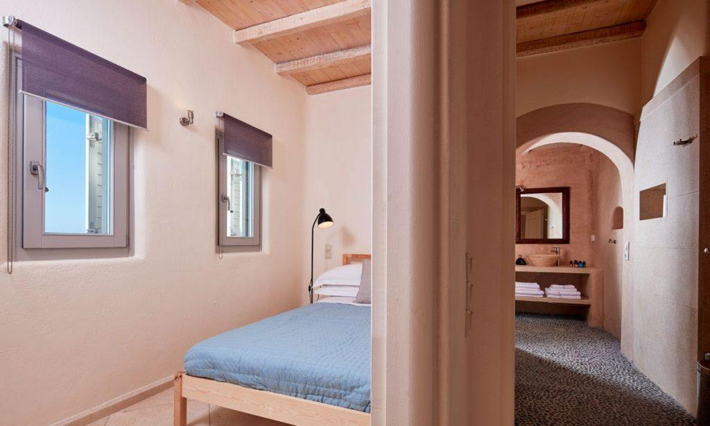 Villa Orion Retreat, Houlakia, Mykonos, bedroom, single bed, windows, pillows, lamp, blanket