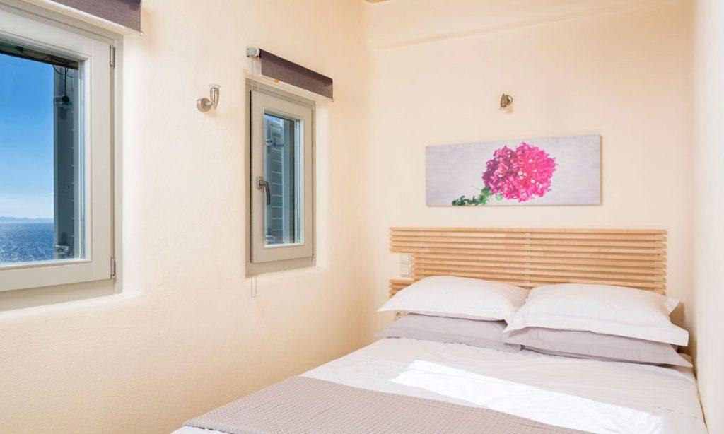 Villa Orion Retreat, Houlakia, Mykonos, bedroom, windows, painting, bed, pillows, blanket, curtains