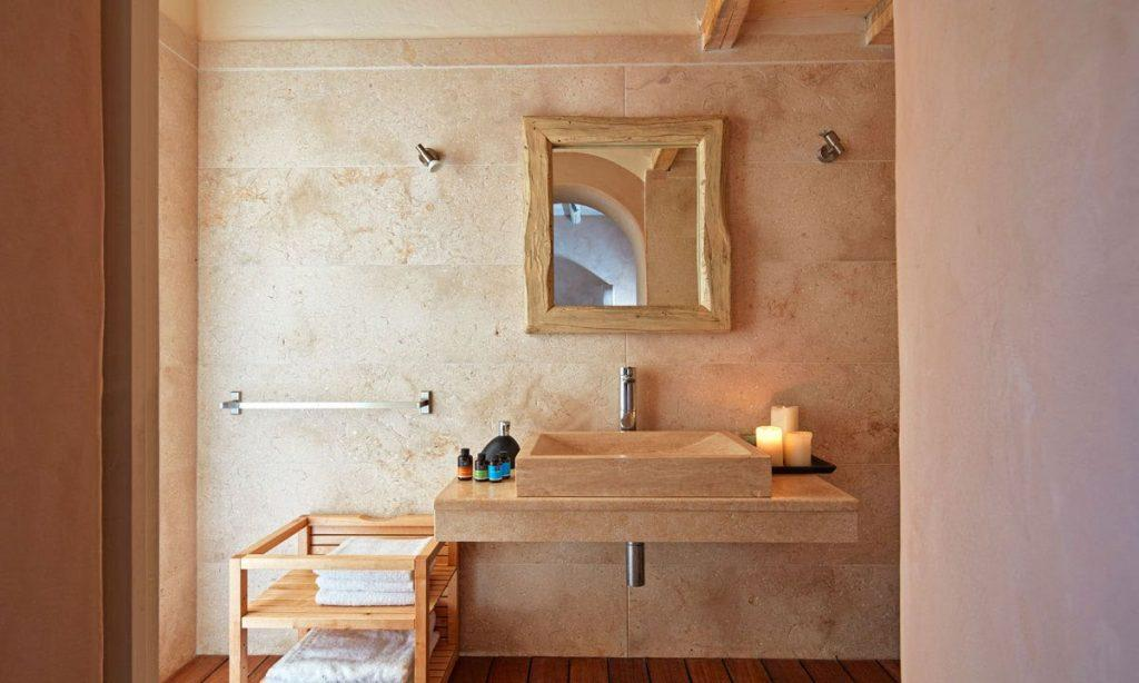 Villa Orion Retreat, Houlakia, Mykonos, bathroom, washstand, mirror, towels, candles, soap
