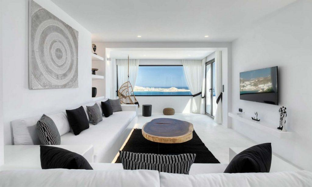 spacious living room with white couch table to chill and watch TV