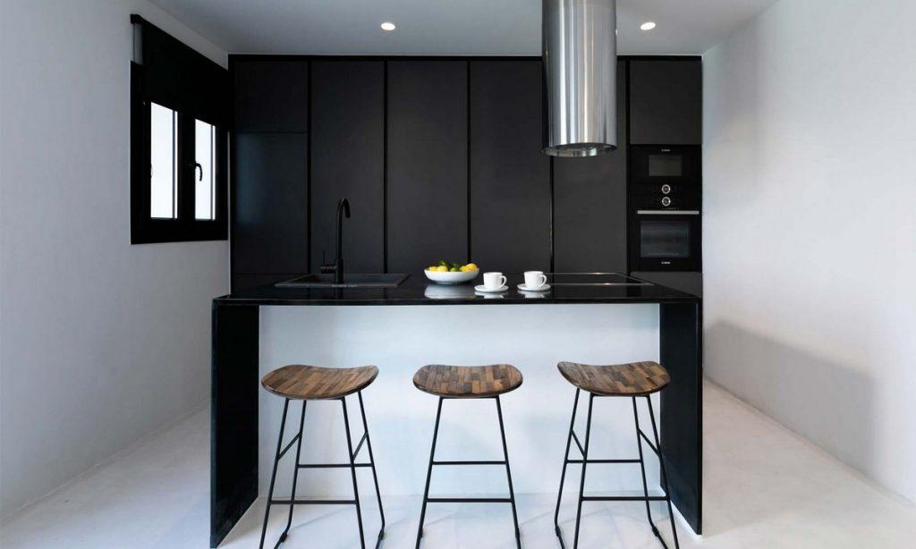 applied layout kitchen with over the counter type table and elevated chairs
