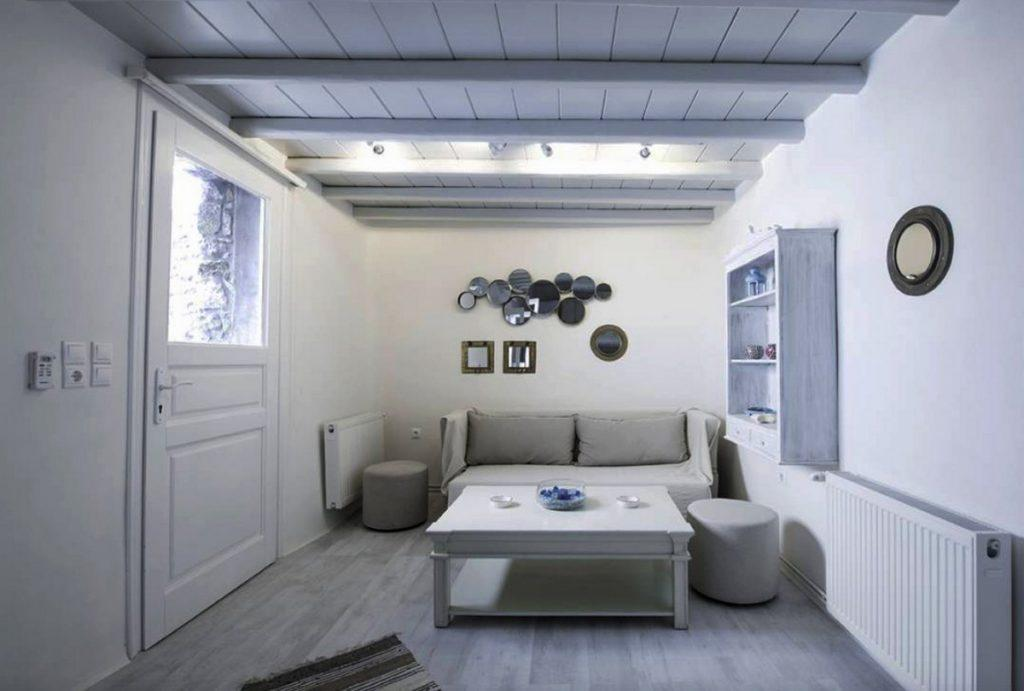 white wall area with grey couch