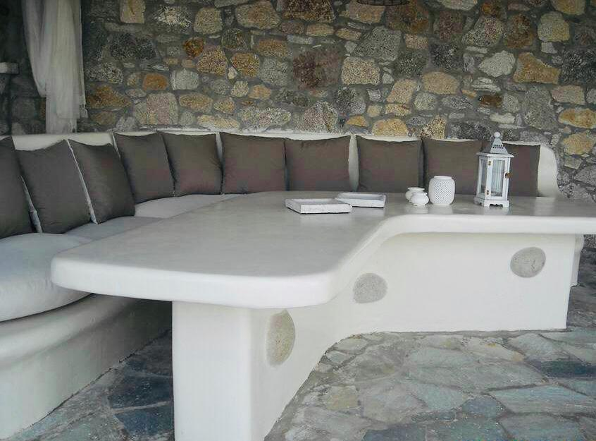outdoor area with ceramic table and soft pillows