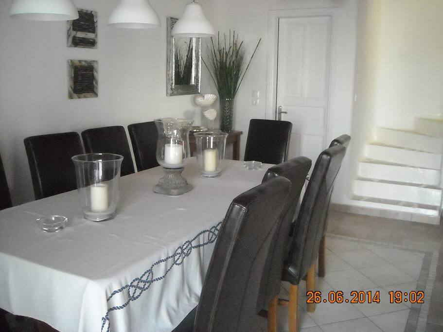 dining area with black chairs and huge table