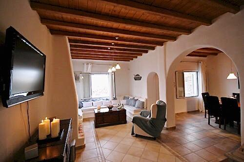 living area with flat screen tv and candles