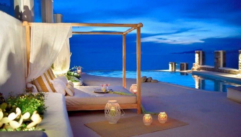 outdoor area with comfort bed and candles for romantic atmosphere