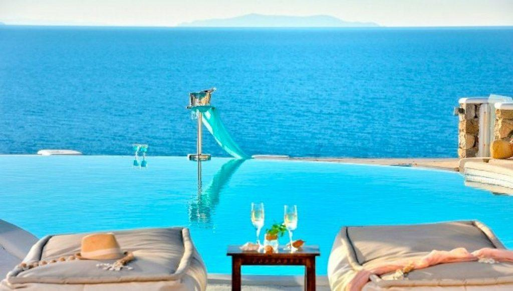 outdoor area with pool and beautiful sea horizon view