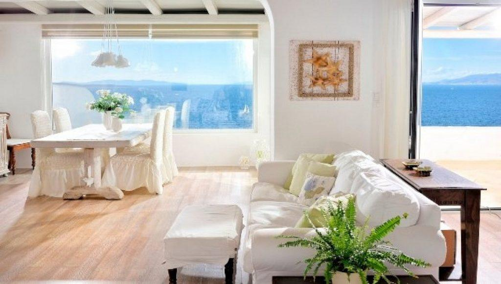 spacious area with soft white couch and ceramic table