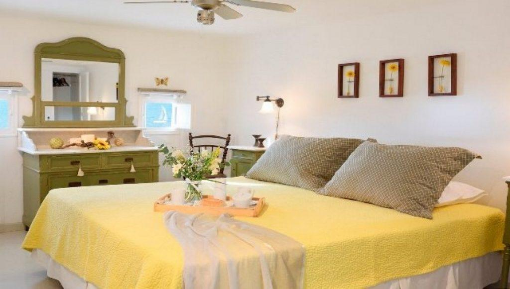 bedroom with yellow sheets and soft pillows