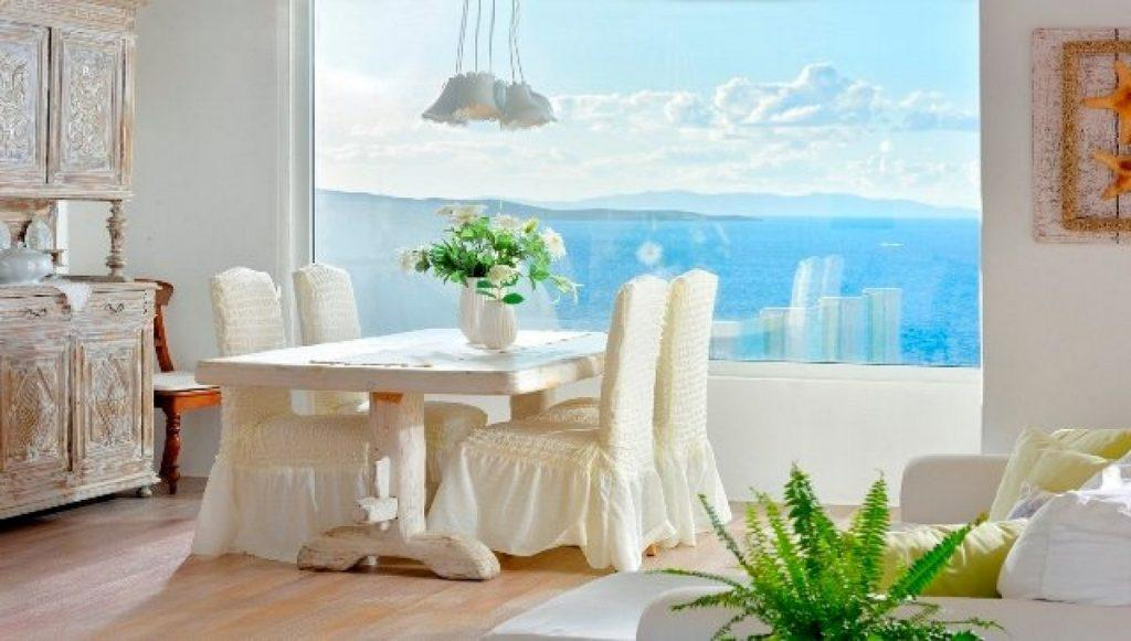 dining area with white table chairs and old wooden cabin
