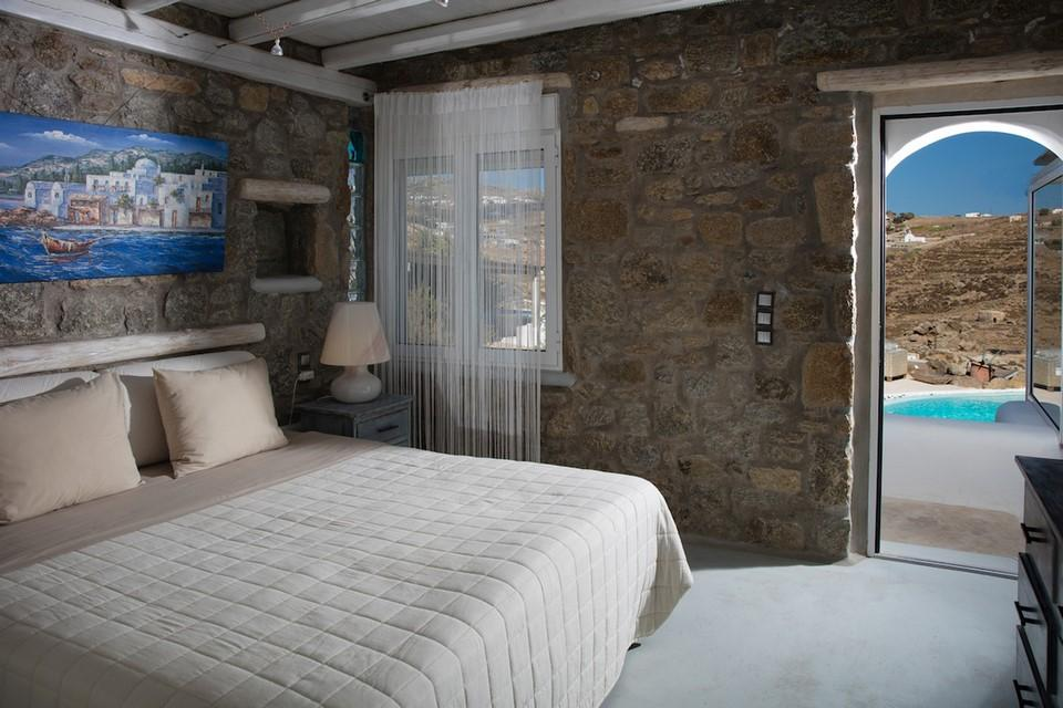 stone bedroom walls with paint and huge comfort bed