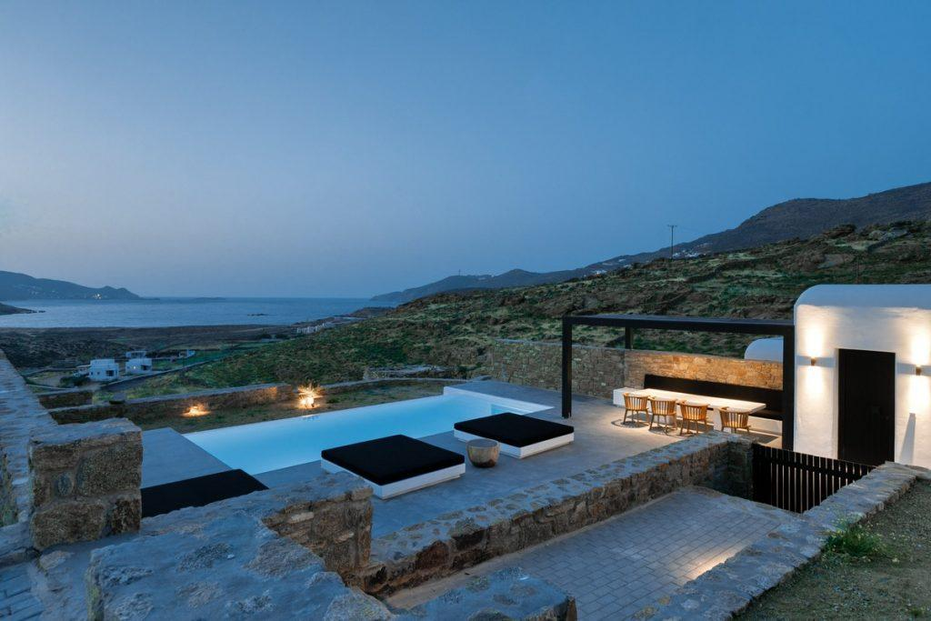 outdoor area with lit villa walls and soft climbers