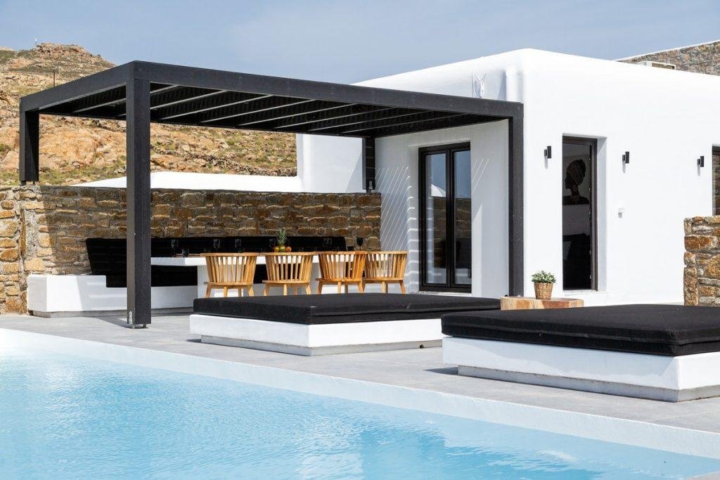 outdoor white villa walls and black wooden canopy