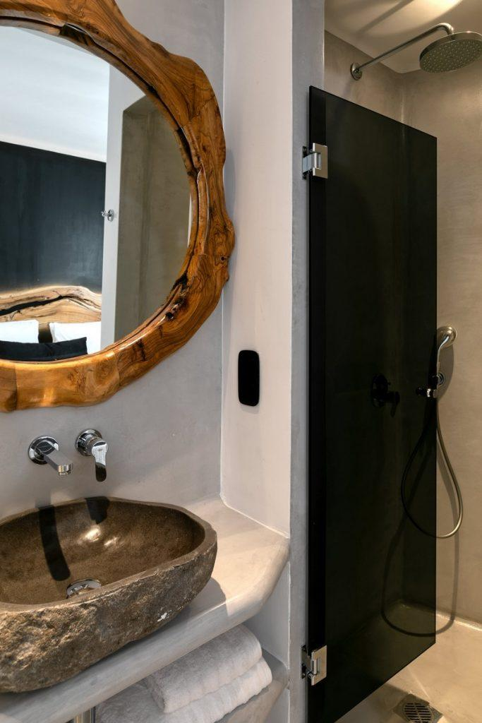 bathroom with ceramic sink and wooden mirror frame