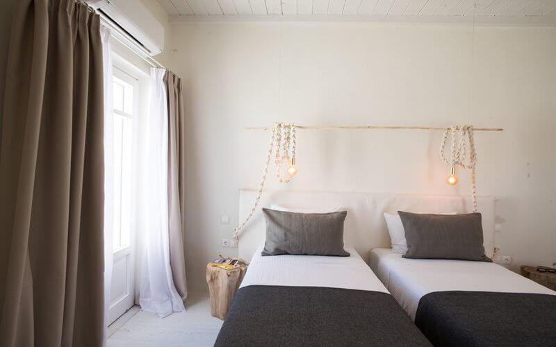 bedroom with rope designed lamps and air condition