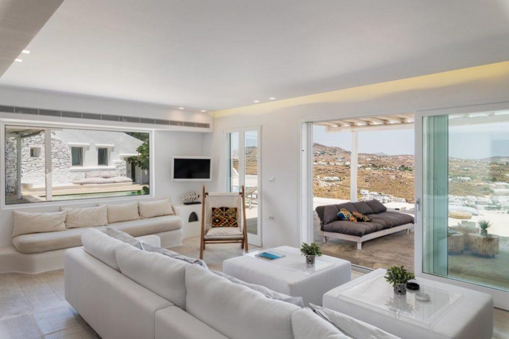 spacious living area with white comfort couch and flat screen tv
