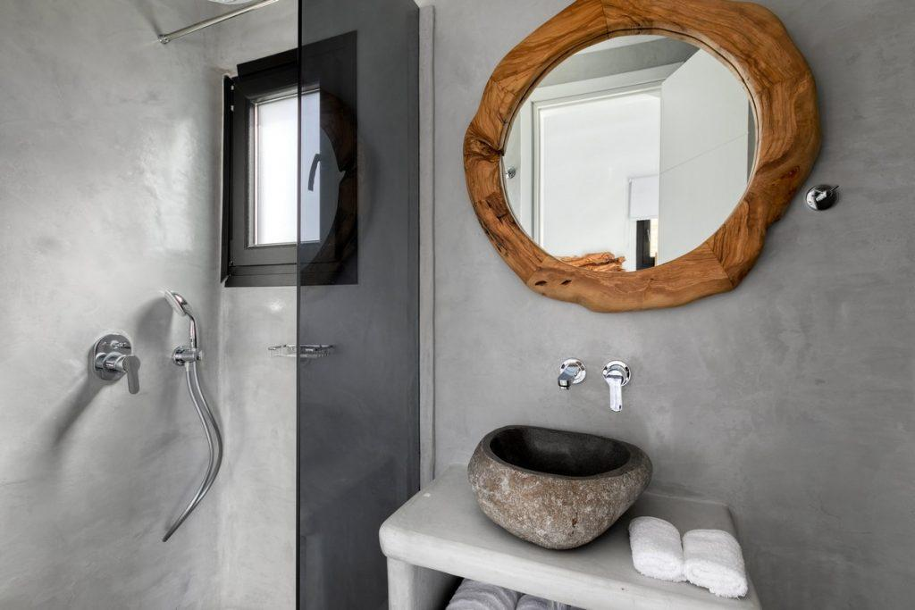 bathroom with small window for light and shower