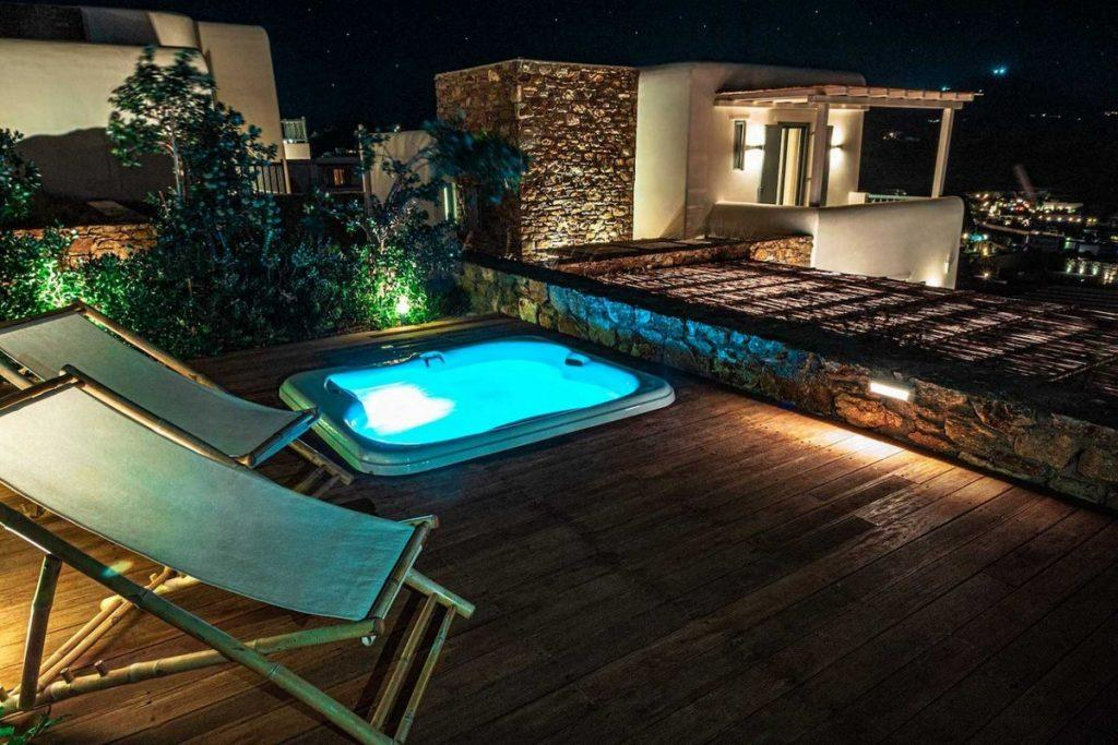 outdoor area with lit jacuzzi to lay down and relax