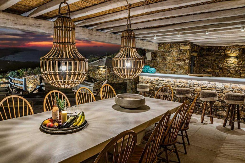 outdoor dining area with ceramic table and fruit basket