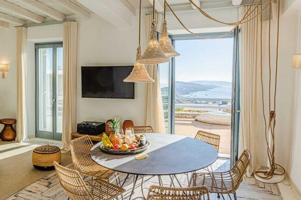 dining area with hanging lamps and round table