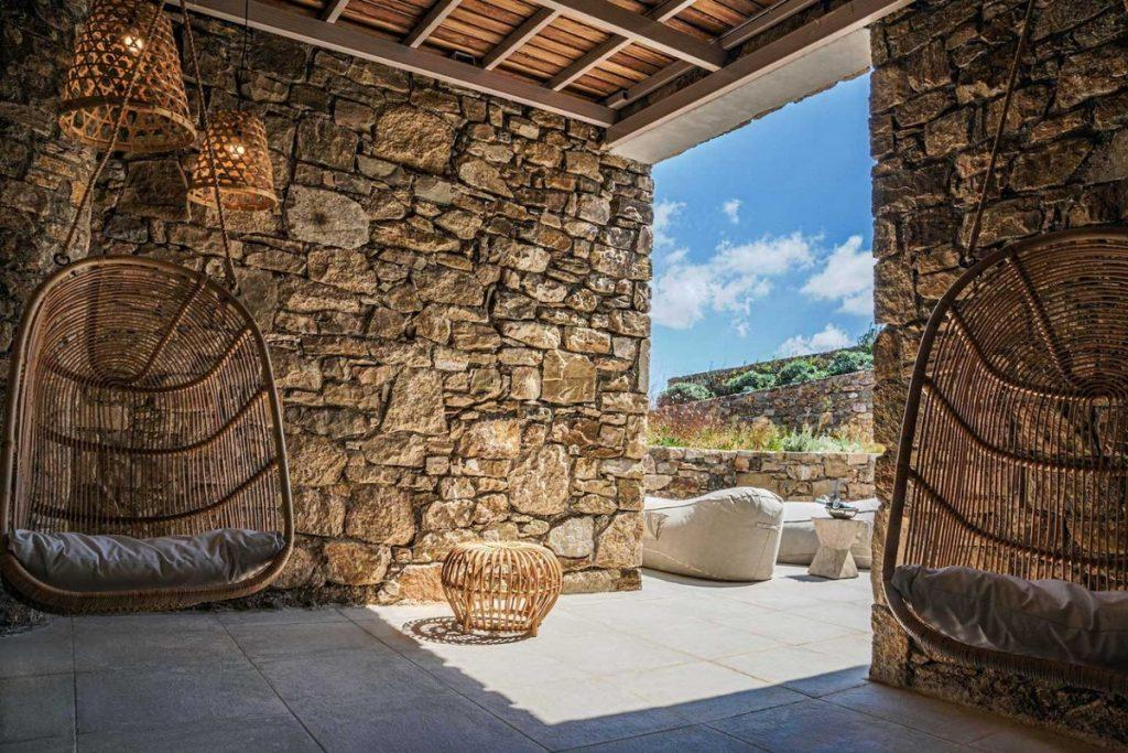 outdoor area with stone walls and swings