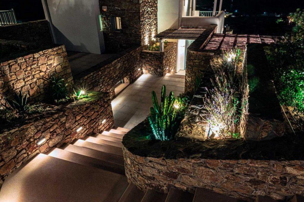 outdoor area with lit stairs and green surface