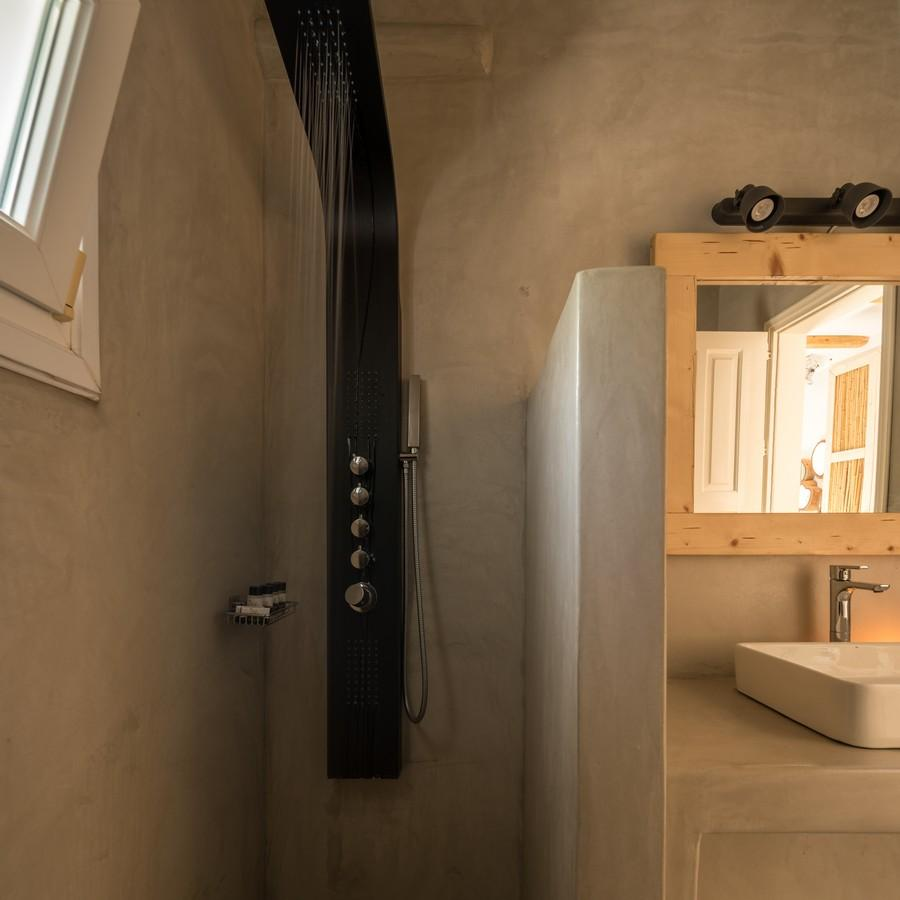 bathroom with unique designed shower and small windows